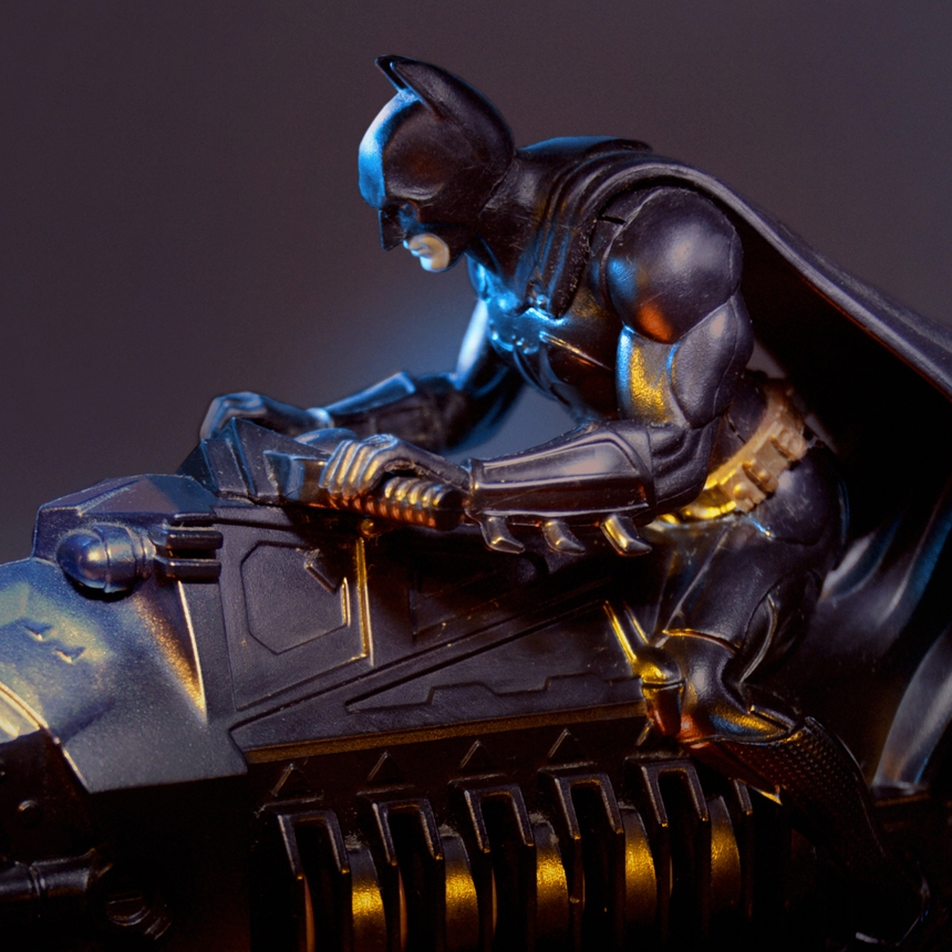 Detail of Batman with yellow and blue lighting