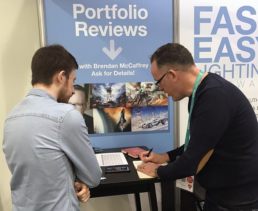 Brendan McCaffrey reviewing portfolios