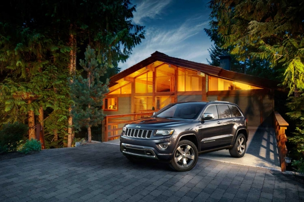 Jeep by house by Mid Coast Studio